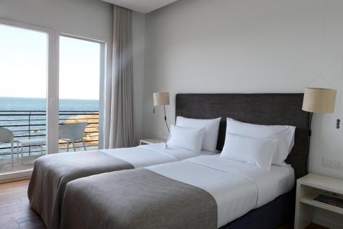 Habitación Doble con vistas al mar y balcón Hostal Spa Empúries 13