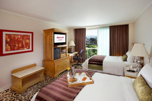 Deluxe Guest room, 2 Double Beds,A City view (Deluxe Guest room, 2 Double Beds, City view )