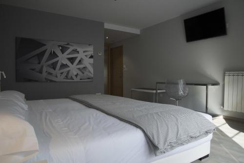 Habitación Deluxe con cama extragrande Lar de Donas 3