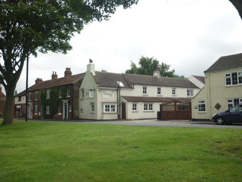 The Village Inn - Photo 2 of 29