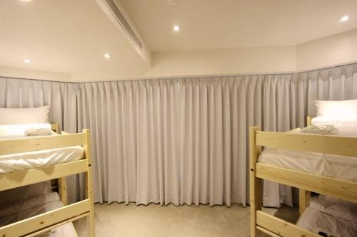 4 床女性宿舍房的 1 個床位 (Bed in 4-Bed Female Dormitory Room)