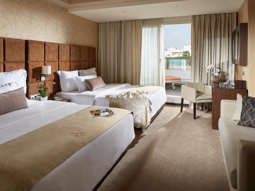 Villa Blanca Urban Hotel istabas fotogrāfijas