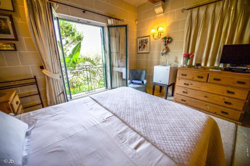 Selmunett – Malta Homestay zdjęcia pokoju