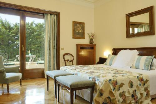 Habitación Familiar con acceso al spa (2 adultos + 2 niños) Hostal de la Gavina GL - The Leading Hotels of the World 8
