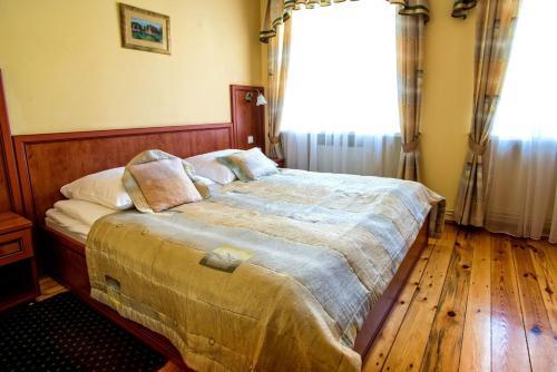 Hotel Adalbertus istabas fotogrāfijas