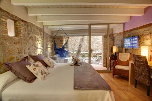 Habitación Doble Deluxe con jardín privado Hotel La Freixera 6