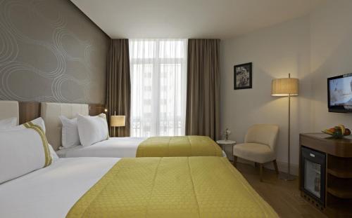 Senator Hotel Taksim Улучшенный двухместный номер с 2 отдельными кроватями