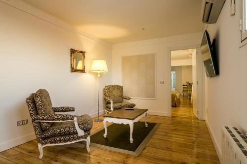 Habitación Doble Deluxe Hostal Central Palace Madrid 38