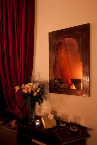 Riad Assouel istabas fotogrāfijas