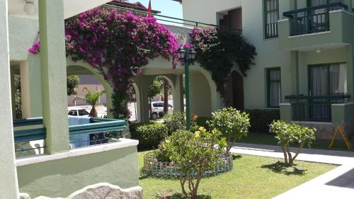 Фото отеля Avlu Apartments 1