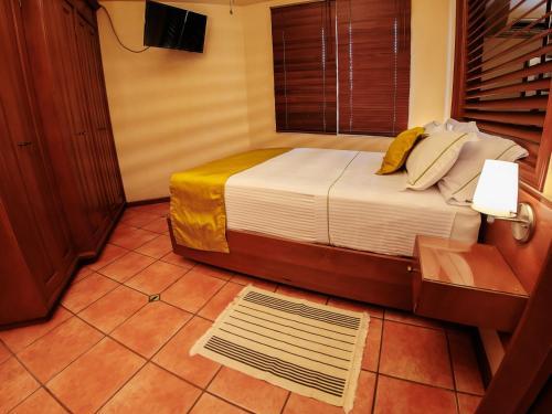 Photo - Alcazar Suites