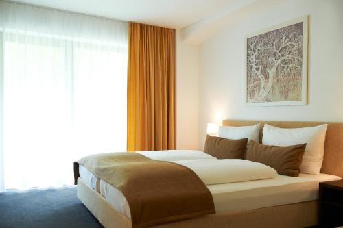 Фото отеля Hotel Garni Tannleger B&B