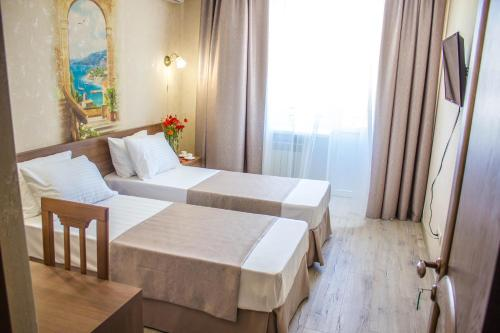 Cameră cvadruplă cu balcon (Quadruple Room with Balcony)
