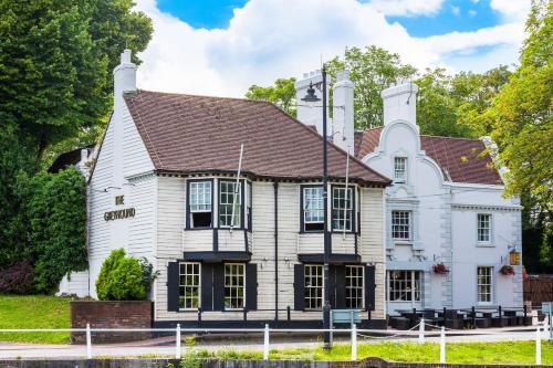 High Street, Carshalton, Surrey SM5 3PE, England.