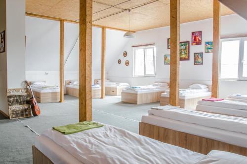 «в Лайк хостел» Односпальная кровать в общем номере