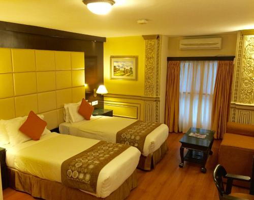 Double Room Relaxation Package - One Time Ayurvedic Massage, 20% Discount on Food and Beverages and Laundry, Welcome Drink and Hi Tea, Flexible Checkout Time and more addons