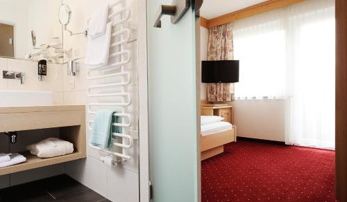 Фото отеля Hotel Alp-Larain