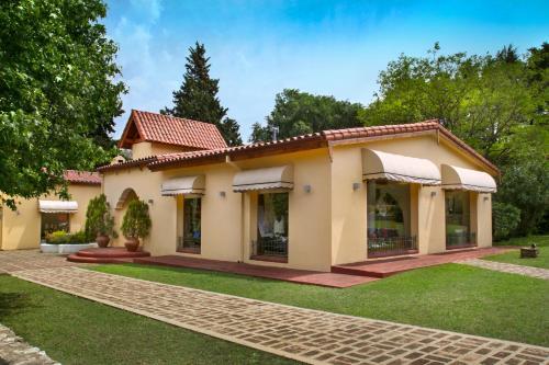 A Hotel Com Altos De Belgrano Hotel Cabañas Golf Y Spa