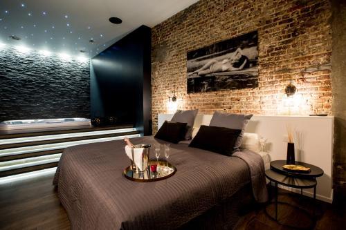 Hotel chambre avec jacuzzi sauna privatif