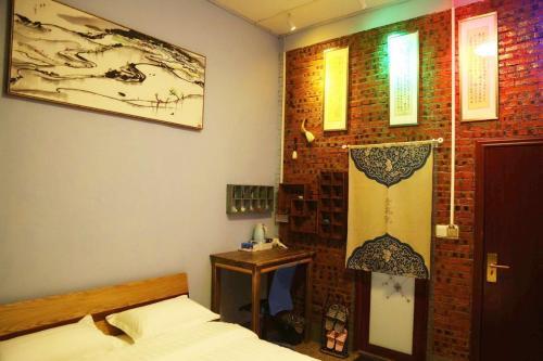 Фото отеля Zhaohuaxishi Youth Hostel