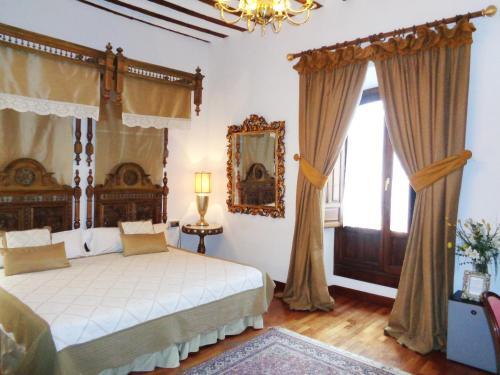 Habitación Doble con cama supletoria  Hotel Boutique Nueve Leyendas 41