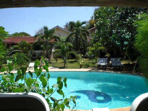 . Frangipani Cottages