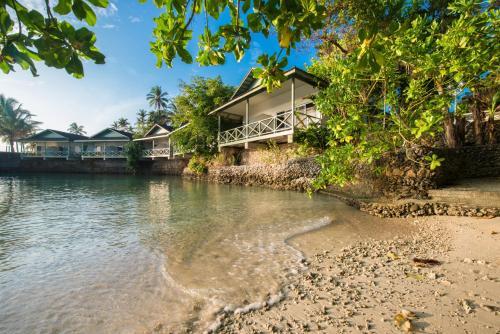 Фото отеля Kalibobo Village