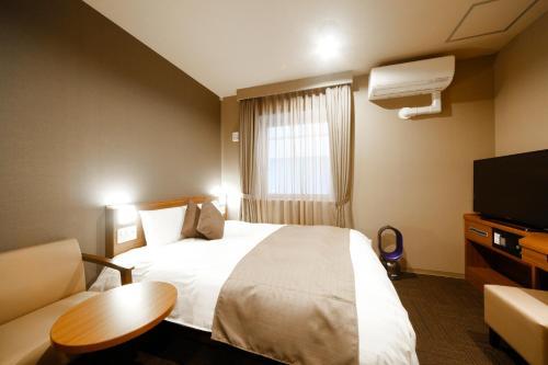Dormy Inn Toyama Natural Hot Spring 房间的照片