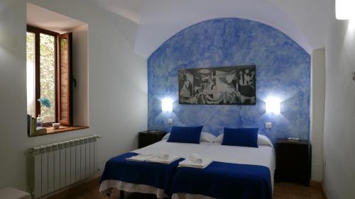 Habitación Doble con cama supletoria - 2 camas La Posada de Grimaldo 1