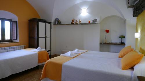 Habitación Doble con cama supletoria - 2 camas La Posada de Grimaldo 3