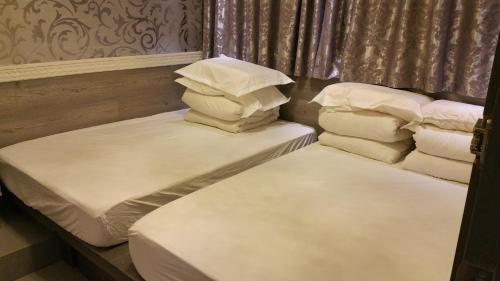 Thai O G Hotel istabas fotogrāfijas