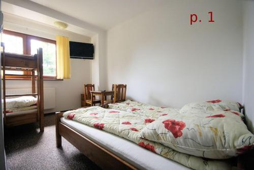 Chambre Quadruple avec Salle de Bains Privative (Quadruple Room with Private Bathroom)