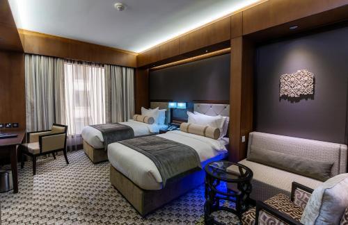 Ayla Grand Hotel room photos