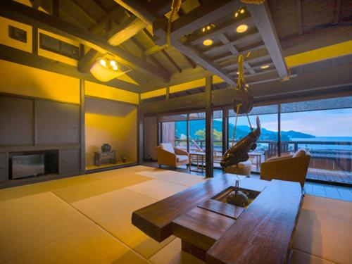 Room with Tatami Area with Open-Air Bath and Sea View