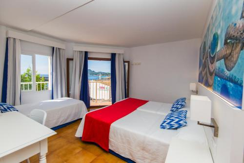 Cameră triplă cu vedere la mare (Triple Room with Sea View)