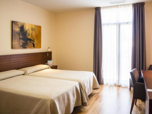 Double or Twin Room - single occupancy Hospedería Puente de Alconétar 32
