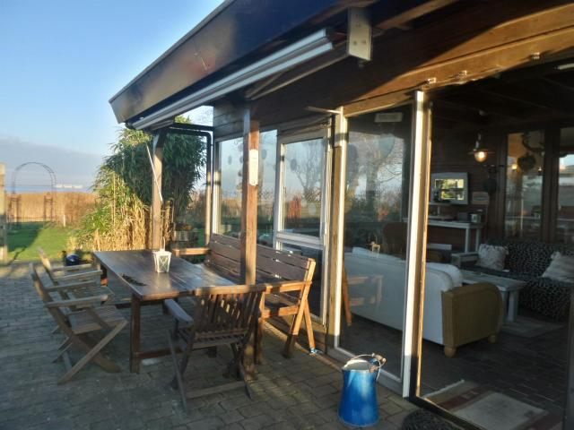 House Marijke with winter garden and direct access to the Lauwersmeer