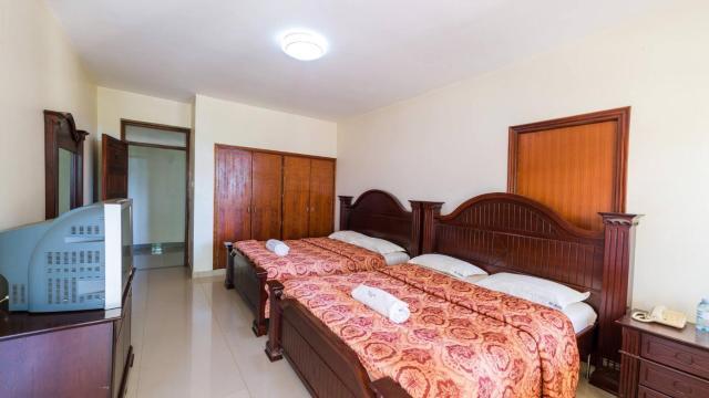 Room in Guest room - Trendy Deluxe Twin Rooms In Masaka - 1