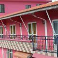 Paradisia Holiday Inn - foto hotel dan kamar