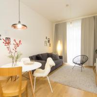 Modern, new apartment with garden