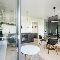 Midcentury Modern Riverside Apartment with Garden