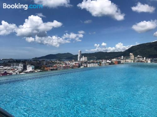 One bedroom apartment place in Patong Beach with pool and terrace.